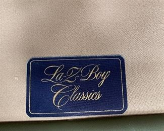 Like New La-Z-Boy Classics gray leather chairs each with an ottoman