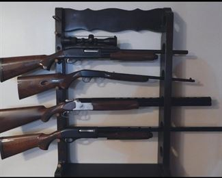 Like new hunting  rifles and shotguns.  From top to bottom:  1:  Remington 870 Wingmaster 20 ga. w/choke tube barrel and fully rifled barrel w/mount and scope.  2:  Browing Auto 22 Japan made.  3:  Huglu 12 ga. over under w/ chock tubes.  4:  Remington 870 Wingmaster 12 ga.  3 1/2 inch chamber with 2 choke.