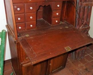 Lot 1  Antique two piece fall front desk with 27 small interior drawers  $200.