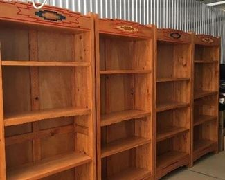 Four matching Southwestern Rustic bookshelves with adjustable shelves.  Carved across top like the other matching pieces.