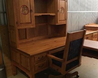 Contemporary Rustic  style  furniture with US Marine insignia.  Includes sectional desk with hutch.  Hutch has shelves in both cabinets and desk has    a pullout for keyboard.  Also available is the desk chair, 4 matching bookshelves, 2 drawer file cabinet and credenza.  Definitely a nice conversation piece for just the right office.