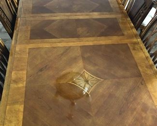 Dining room table with six chairs. Comes with two leaves and table Pads