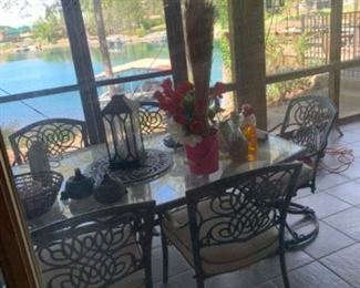 Very nice patio set with glass top, 6 chairs and seat cushions.