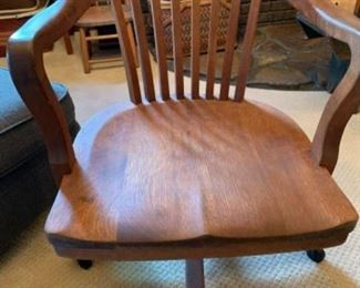 Antique solid oak office chair with original hardware underneath.