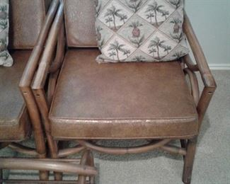 "Pair (2) Ram-Tan Brand Rattan chairs with cushions & Magazine rack, Excellent condition, approx measurements: 26""wide x 30"" tall x 28"" depth"