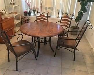 Wrought Iron, and Wood Table; top and iron and brown upholstery seats are all in excellent condition.