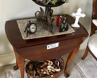 One of 2 vintage drop leaf tables