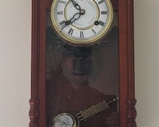 Commemorative wind up wall clock.