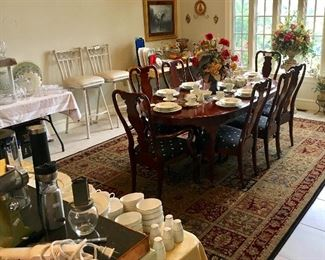 Very Fine Cherry wood Dining table, chairs, and fine china. Table does have extension leaf.
