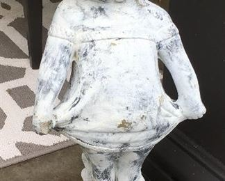 Concrete Statue of little girl pulling dress.
