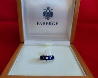 $1500.00 - Faberge Ring, Bearing the Number 199/300 18k, Diamond 0.17. Certificate of Registration provided.
