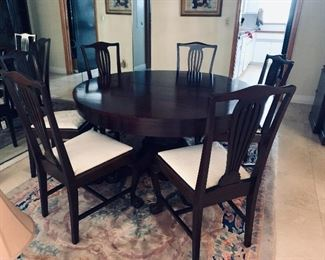 The table is sold. The chairs are still available for purchase.