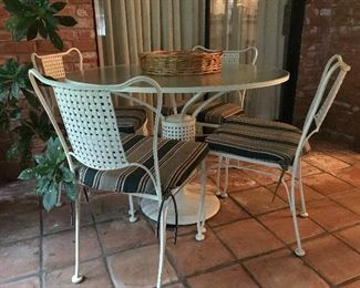 Dynamic Glass Top Patio Table & Four Matching Chairs   390