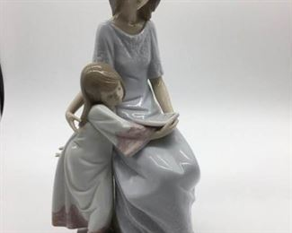 Lladro figurine titled ''Bedtime Story'' https://ctbids.com/#!/description/share/412548