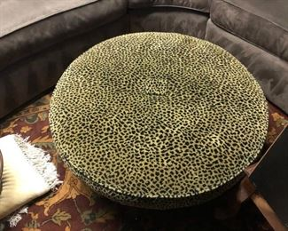 SOLD.  Leopard ottoman that can be used as a foot stool, center piece, seat, or even a game table for kids. Excellent condition.