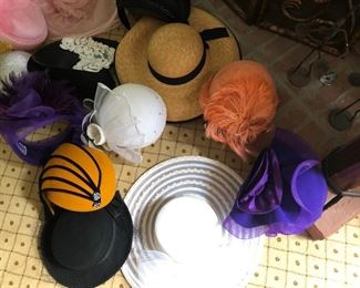 Original handmade hats of various assortments. Prices range from $30.00 - $70.00.