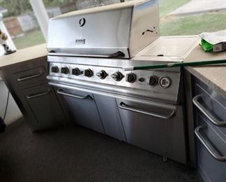 Outdoor kitchen with gas grill drawers counter tops very nice set