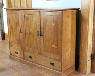 Stickley TV Entertainment Center Solid wood. Some scuffs at bottom, Right swinging door hinge needs to be fixed. Rubbed bronze fixtures. Several shelves, one pulls out completely. 2 drawers in bottom. Good working condition.