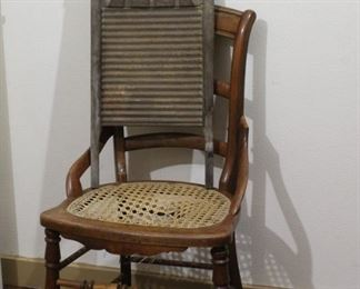 """Cane seated antique chair and washboard Caning needs to be prepared. Rest of chair is sturdy and in good condition. Antique washboard has faded writing """"National Washboard Co."""" and """"Top Notch""""."""