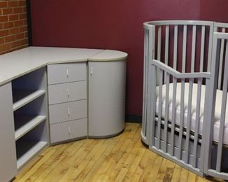 Italian made modular baby unit Grey and cream laminate. Crib w/bottom drawers and casters. Storage unit with multiple storage cabinets. Top shelf is removable and folds out. Made in Italy. Crib is not to be used for babies or children.