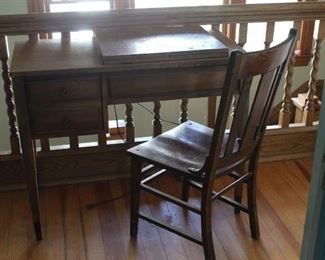 Sewing machine cabinet, machine and chair Singer touch and sew, wooden cabinet is in worn condition and ready for refinishing, chair is sturdy with some paint spots. Comes w/foot pedal, extra bobbins, oil.
