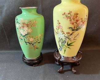 "Asian Item 8	 2- metal Cloisonne 7"" vases: 1-yellow, 1- green on wooden pedestals; Note: see photos"