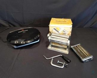 Kitchen Appliances Two kitchen appliances used George Foreman grill powers on with drip tray and pasta maker