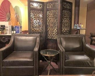 2 Dark Chocolate Leather Arm Chairs with nail-head trim. Excellent Condition. (The partition behind the chairs is Not For Sale.) These chairs are priced separately.