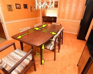 """Item 3: Dining Table & Chairs: $875    Boat-shaped table with two leaves. Comes with six upholstered chairs. Two armchairs, four side chairs, upholstered in neutral tones nubby fabric. Shades range from slate gray, to """"natural"""", black, beige, and brown. Stickers on chairs are for """"Contemporary"""" a furniture store on Harvard Street in Brookline once upon a time."""