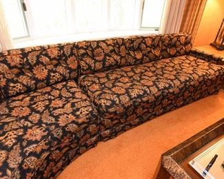 Item 5: Black floral curved sofa: $325      Anthony C. Sabbia Interior Design, Newton. Upholstery is in excellent condition, Black field with orange, brown, bronze, tan flowers.