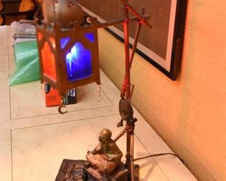 Item 8: Austrian cold painted Orientalist bronze lamp, in the style of Franz Bergman. $1200    No foundry marks or signatures present (green felt removed from base to check). In good condition. Glass appears to be original. One small split in metal on upright - see photo.