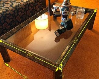 Item 14: Glass top coffee table: $185      Wood frame, painted in drippy metallic paints. Gold, bronze, copper tones. Very good condition