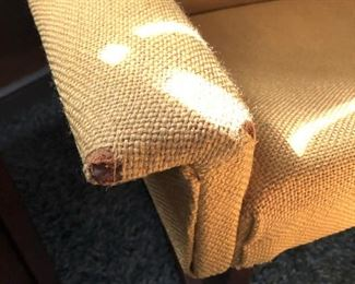 Item 17: Midcentury Lounge Chair & Foot Rest  $ 425  Unmarked. Upholstered in yellow loose-weave fabric. The upholstery is soiled and has holes at wear points. Frame of both chair and foot rest are sound.