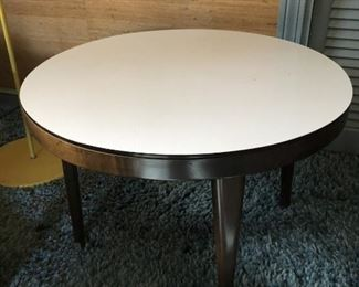 Item 19: White laminate top round side table  $30  In good condition