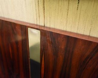 Item 20: Rosewood King Headboard: $225   Rosewood panels separated by recessed chrome strips, surrounded by black laminated wood. Fair condition.