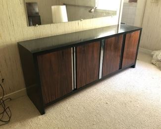 Item  22: Rosewood Dresser    $185  Rosewood doors with recessed chrome strips, framed in black laminate on wood. Doors open to drawers. Fair condition