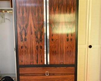 Item 23: Rosewood Wardrobe   $250   Rosewood doors with recessed chrome strips. Drawers have chromed pulls. Fair condition