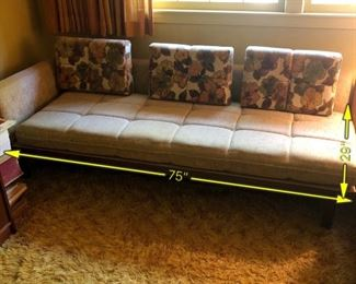 Item 24: Mid Century sectional  $345    Platform Sectional sofa with an attached side table. Upholstery is in good condition, although there is a duct tape repair on one arm. Attached side table has a faux wood laminate surface. Frame is sturdy and in good condition.