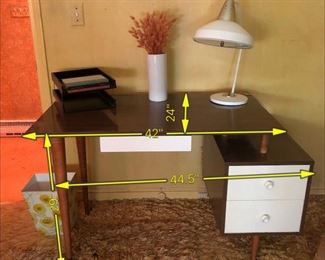 Item 26: Compact Mid Century Desk  $245  Tops have wear and white spots. I think they'll come off with some effort. Some paint loss on knobs. White laminate covers all three drawers. Dovetail joints.