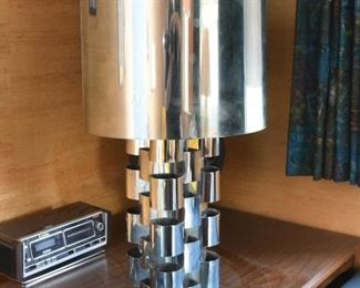 Item 29: Monumental Curtis Jeré Chrome Lamp $385  Minor dings in barrel shade. Base has had paint loss, spot repairs are visible. Some areas of chrome need to be polished after a deep clean.