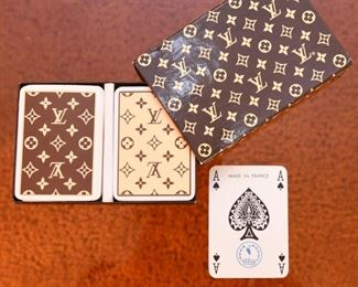 Item 39: Vintage Louis Vuitton Playing Cards $125   1970s, Made in France by Heron. Logo box holds two decks of cards. One deck is brown, the other is cream. Both decks have all 52 cards, plus 2 jokers, and one with instructions. Cards have gilt edges. Paper has remained bright white. These are in exceptional condition.