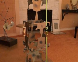 Item 42: Brutalist metal sculpture $45  Abstract shape tower.