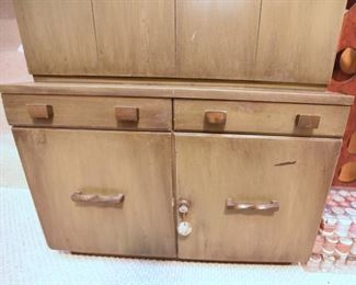 Item 46: Bar cabient $95   Weathered green midcentury brutalist bar cabinet has locking storage in the bottom. The top flips open to lift up a shelf with storage for differnt size drinkware. Even has small scale hydraulics to allow the shelf to sink back in gently and close softly. There's enough overall wear and damage from use that this will be a project.