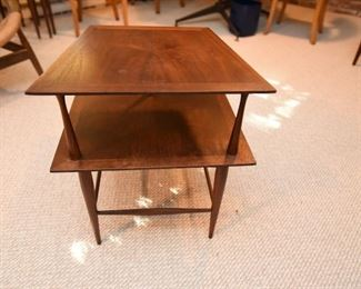 Item 50: Two-tier Rosewood End Table $70   Unmarked end table with particularly slim supports. Wood is in good condition, some minor water damage on surface.
