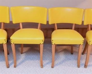 Item 51: PENDING Set of 4 Yellow Vinyl Chairs  $160  Brilliant yellow vinyl, finished with nailheads at legs and on the back. All chairs have minor water damage at the bottom of legs. Overall good condition.