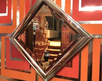 Item 56: Chrome frame square mirror  $120