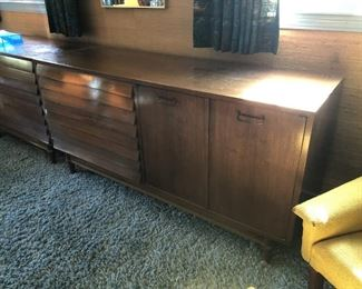 Item 60: American of Martinsville Double Dresser  $185  Louvered drawer fronts, doors open to reveal more drawers. Fair condition. Deep marks on top surface, some dry spots.