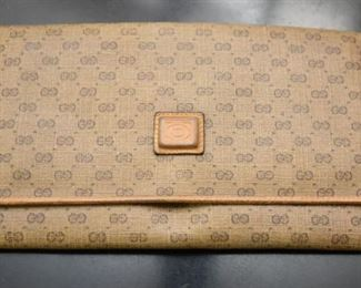 Item 67: Vintage Gucci Wallet Clutch  $25  Wear especially evident on corners. Interior pockets are marked up from coins and pens.