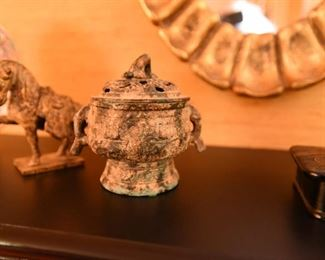 ITEM 73: Two Chinese Bronze Items  $30  Small patinated cache pot and war horse.