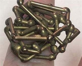 ITEM 86: Brass ring $22   Approximately size 7, this ring is comprised of a tangle of brass rods with bulbous ends.